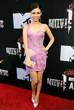 Victoria Justice wears an Atelier Versace mini dress, Brian Atwood heels and an Edie Parker clutch at the MTV Movie Awards