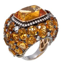 Ring in 18k rose gold and palladium with 28.15 cts. t.w. citrine, 5.05 cts. t.w. orange sapphire, and 2.08 cts. t.w. diamonds, $16,080; Zorab Atelier