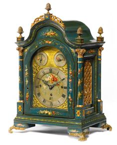 A GEORGE III PARCEL-GILT GREEN-JAPANNED AND POLYCHROME DECORATED MUSICAL TABLE CLOCK, Robert Ward<br>London, Circa 1780 | Lot | Sotheby's