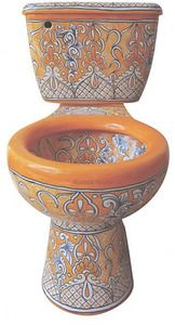 Mexican Talavera toilet set. Matching sink, soap dishes, towel holders and toilet seat available. Enough styles for a  different design for every bathroom on the block.