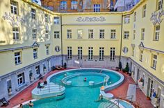 Swimming in snowfall – the Saint Luke's bath of Budapest Have you ever swimmed in a pool, while snowflakes were falling out of the sky? When you are in Budapest at wintertime, do not miss the feeling. Budapest Thermal Baths, Winter Time, Bugs, Saints, Swimming, Sky, Mansions, House Styles, Swim