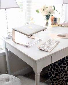 Gold laptop stand with wireless keyboard and mouse for home office