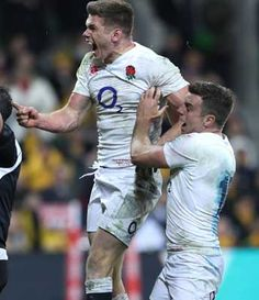 Owen Farrell celebrates with George Ford after scoring the winning try during…