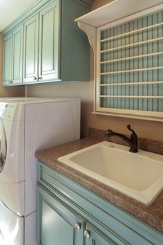 This drying rack over the laundry sink folds up when not in use. // via @martin Brothers