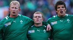 Choirboys: Leo Cullen, left, sings Ireland's national anthem with Keith Earls and Donncha O'Callaghan before the match against Russia