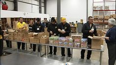 Food bank recruits local sports team to draw volunteers to food drive