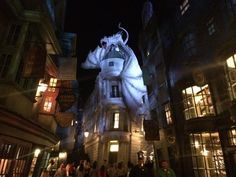 """Guests approach the Wizarding World's London Waterfront from either the San Francisco or World Expo areas of Universal Studios, at the opposite end of the park from the front entrance. Wrought iron fencing surround the park-like promenade (complete with snack and souvenir stands, and a towering statue-topped fountain) with a shoreline sidewalk along the embankment bypassing the area. Guests access London through the gateway closest to the """"Fear Factor Live"""" stadium, and exit towards…"""