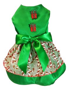 Handmade dog dress constructed from green satin fabric with candy cane overlay skirt.. Accented green shear bow at waist and embellished with gingerbread men buttons on the top. Lined to insure comfor