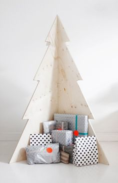 "This ""tree"" creates a simple, rustic nook in which to nestle your Christmas gifts.   What more could you need?"