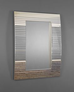 Hopetoun - Mirrors, This sensational Venetian style mirror has a stunning modern design with a chic retro feel. A central rectangular pane of mirrored glass is set back within a wider frame with a gently bowed profile. The frame is panelled with slender bevelled glass tiles that are angled in minute gradations to follow the curved contour, creating a sparkling banded design.