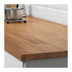 HAMMARP Countertop, oak oak 98x1 1/8 solid wood counter top. Handy man will need to cut down. Pair with white shelves.