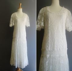 The confirmation dress had longer sleeves like this, a sccop neck like this and the drop in the waist was more like this one as well.  Vintage 1920s OUT OF A DREAM White Lace Flapper Wedding Dress