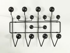 The Hang It All, originally designed as a children's wardrobe by Charles and Ray Eames, which to date has been available in colourful and bright versions, is now additionally available in black and brown versions.