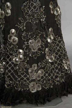 BLACK CHIFFON & SEQUIN BALLGOWN, c. 1905 black chiffon over black silk, trimmed in nipple shaped ombre gray sequins & lattice pattern cut steel beads, off the shoulder bodice w/ narrow shoulder straps, chiffon flounced sleeves, trained skirt,