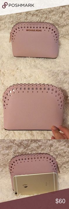 Michael Kors Cosmetics Case Pink 🌸 Brand new cosmetics case. Lost the tags. Never used because it was too small for me. iPhone 6+ used for scale in photos. Stored away properly. Comes from smoke and pet free home. Michael Kors Bags Cosmetic Bags & Cases