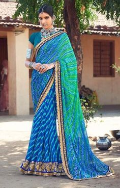Price @3250.00 INR Colour : Green & Blue Saree Fabric :  Georgette      Blouse Fabric :  Fancy Blouse            Work :  Heavy Embroidery