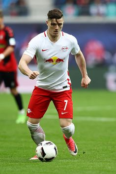 Marcel Sabitzer Photos - Marcel Sabitzer of Leipzig in action during the Bundesliga match between RB Leipzig and SC Freiburg at Red Bull Arena on April 2017 in Leipzig, Germany. - RB Leipzig v SC Freiburg - Bundesliga Fifa, Sc Freiburg, Marcel, Red Bull, Germany, Soccer, Action, Running, Squad