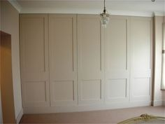 FITTED WARDROBES & CABINETS in a hallway for all our off season clothing.