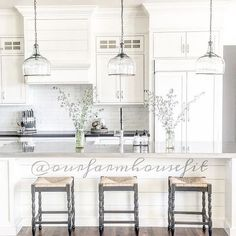The room may receive welcoming glow thanks to big pendant lighting that gives stair landing. Meanwhile, other items are located in one strategic spot to deliver bright beams like installed above kitchen island, cutting board of above memorable family photo.