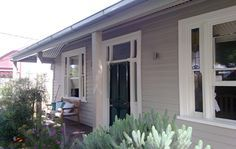 The weatherboards are 'Linseed' and the windows are 'Ecru 1/4 strength' www.sterlingpainters.com.au