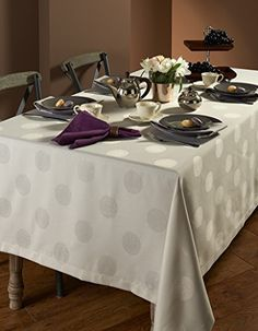 A stylish host wants to set up a beautiful dining table even on the busiest of days. Meet our Esse collection; specially designed with a soft dots pattern to combine the look and feel of a fine table cloth with an easy-care finish, making your clean up easy and simple. Specially coated to prevent wine and other liquid stains from forming. Machine wash in cold water, with like colors, using a non-chlorine bleach detergent. Airdry on flat surface, no ironing needed. 100% Polyester.