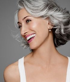 Beautiful salt & pepper hair on gorgeous woman. That is the way to go if going all gray when getting older.
