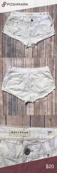 White Denim Distressed Shorts These slouchy white denim ripped shorts are perfect for the summer. Since they are white, they match with any top! They have only been worn 3 times. There are some black mark's on them which are shown in the last picture. I think they can be removed, and I will be happy to work on the stain if anyone has any advice! Bullhead Shorts Jean Shorts