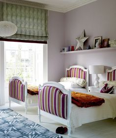 Look for unexpected places to add colors and patterns like these tufted bed frames.