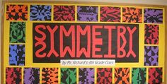 "This bulletin board display that integrates art and math with ""symmetry projects"" is eye-catching."