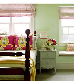 guest bedroom - light green walls with bright, colorful accents