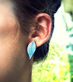 clay leaf earrings. tutorial. clay, leaf for stamping, metallic paint, glue, earring posts.