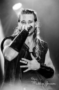 Chrileon - Twilight Force ⚫ Photo by Madelene Jonsson ⚫ Sabaton Open Air 2016 ⚫ #TwilightForce #music #metal #concert #gig #musician #Chrileon #singer #vocalist #frontman #singing #microphone #bracers #coat #leather #beard #earrings #blond #longhair #festival #photo #fantasy #magic #cosplay #sword #larp #man #onstage #live #celebrity #band #artist #performing #Sweden #Swedish #Falun #SOA #SabatonOpenAir