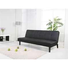 Give your space a vintage mod look with this leatherette futon sofa bed. The textured upholstery is tufted with contrasting stitching. The back folds down to make a comfortable bed for two. With its PU leatherette, you can easily spot-clean this sofa.