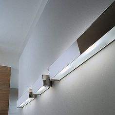 A contemporary wall or ceiling light. Made with a frosted glass shade and a metal frame with a brushed steel or White finish. Provides sophisticated diffused lighting from both sides of the fixture. PLEASE NOTE: THIS IS AN OPEN BOX RETURN ITEM. PRODUCT IS IN NEW CONDITION. ALL OPEN BOX SALES ARE FINAL. QUANTITIES LIMITED TO STOCK ON HAND.