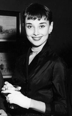 Audrey Hepburn at the Theatre World Award Party in 1952.  Audrey Hepburn in a group photo, at the Theatre World Awards in 1952. She won the 'Promising Personality' award for her role in Broadway play Gigi, which was ran for 219 performances.