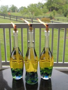 Wine Bottle Tiki Torches! With specific instructions on how to make them... pretty, clear wine bottle(s) / Crafting pebbles / Tiki fuel / Tiki refill wicks / A brass coupling doohickey (the 3/8 x 1/4 fits perfectly)
