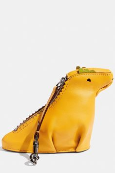It may not be wise to give a dog as a gift, but a dino is fair game.Coach Rexy Coin Case, $95, available at Coach. #refinery29 http://www.refinery29.com/fashionable-christmas-gifts#slide-12