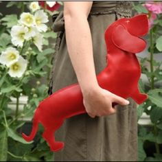Real leather bag in the shape of a Dacshund, available in brown, red or black leather. Designed by Caroline Borger & Klaartje de Hartog. Available for you wiener dog fans