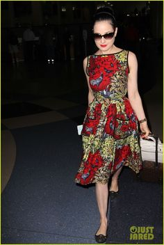 Dita wearing a simple red dress!