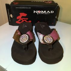 """Spring Special! Nomad Flip Flops SALE These shoes sparkle and are a great addition to your summer wardrobe!  The sole is 1.5"""" thick, so it gives you a little height, too.  Gently used but in good condition.  No rips or tears.  Only sign of wear is the bottom of the shoes.  Great summer shoe! Nomad Footwear Shoes Sandals"""