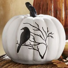 They'll crow about their cool Halloween decor to all they see when you give them this striking pumpkin. This white resin pumpkin is adorned with a starkly contrasted black bird eerily perched on a . Image Halloween, Halloween Home Decor, Halloween House, Holidays Halloween, Scary Halloween, Halloween Crafts, Halloween Decorations, Halloween Labels, Halloween Painting