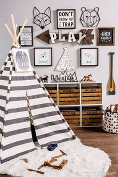 Western woodland themed children's playroom design featuring a gray and white striped play teepee - Unique Nursery Ideas & Children's Room Decor