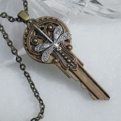 Victorian Silver Dragonfly - Key Pendant I saw a whole shop filled with key jewelry with different things glued on. cool way to use old keys