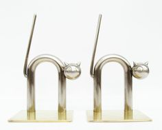 """Pair of industrial Walter Von Nessen polished nickel brass stylized cat bookends for. Previous owner had additional 5/16"""" solid brass plates fabricated to add more weight to the bookends when needed."""