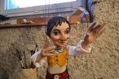 Pinocchio wooden marionette. Classic hand carved puppet