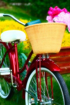 riding on a red bicycle