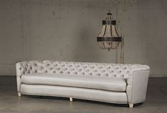 This delicious rounded chesterfield wants to be upholstered in Robert Allen's Open Prairie - Mineral fabric!  The 100% cotton, faded slate colored fabric will make this almost-too-fab-to-sit-on-sofa more inviting and comfortable. #RANaturals