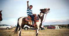 Dakota Access Pipeline - standing-rock-kid-with-fist_h_0.jpg (JPEG Image, 1920×1007 pixels)