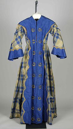 Dressing Gown/Women's Wrapper was straight and full fronts. They were cut wide on the back but still fitted on the shoulders. They were belted and worn open to show the petticoat underneath. These were only worn around the house or around family.
