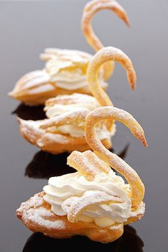 PASTRY SWANS~ Traditional at weddings, French pâte à choux batter is placed in a pastry bag, and the body, wings, and neck of the swans are piped out. After baking and cooling, the body is topped with crème chantilly, and the wings and neck are attached. Voilà! Le Swan!
